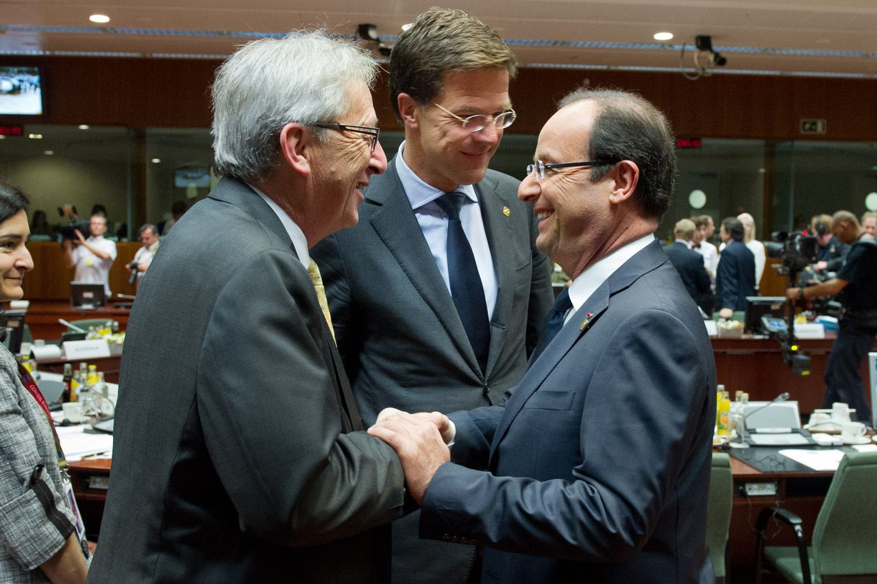 """Luxembourg Prime Minister Jean-Claude Juncker (L), Dutch Prime Minister Mark Rutte talk with French President Francois Hollande prior to a second day of European Union leaders summit in Brussels on June 29, 2012. EU leaders debate """"a big leap forward"""" to strengthen their union and save the euro at a two-day summit starting Thursday, but divisions may scuttle efforts to shore up the single currency. AFP PHOTO / BERTRAND LANGLOIS"""