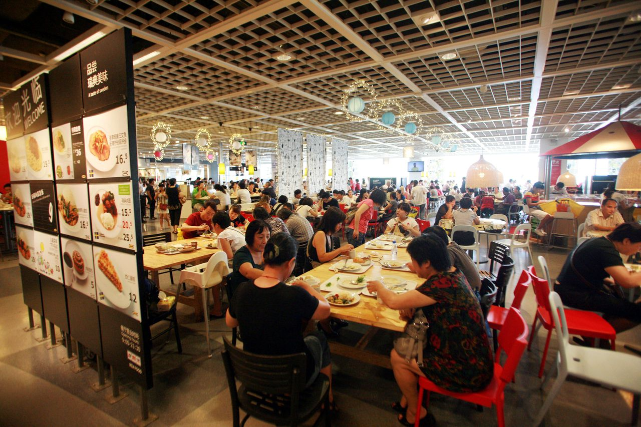 Customers eat food at the cafeteria in the IKEA store in Xuhui District in Shanghai, China, 1 September 2011. IKEA Shanghai said Tuesday (6 September 2011) that it plans to clamp down on unauthorized matchmaking events interfering with weekly Home Lovers Club activities, a nuisance that is to blame for a 20 percent drop in Tuesday cafeteria sales in recent weeks. But with a phantom matchmaking event organizer, the Xuhui District location of the Swedish home decor chain store admitted Tuesday that it is at odds with how to stop hundreds of IKEA club members from regularly crowding its cafeteria, to take advantage of complimentary coffee while banking on meeting that special someone. IKEA started the Home Lovers Club in 2007, which has since attracted more than 1 million local members, a modest number of whom have just started showing up for similar events at the stores second city outlet in Pudong New Area, said Yin Lifang, a public relations officer for IKEA Shanghai.