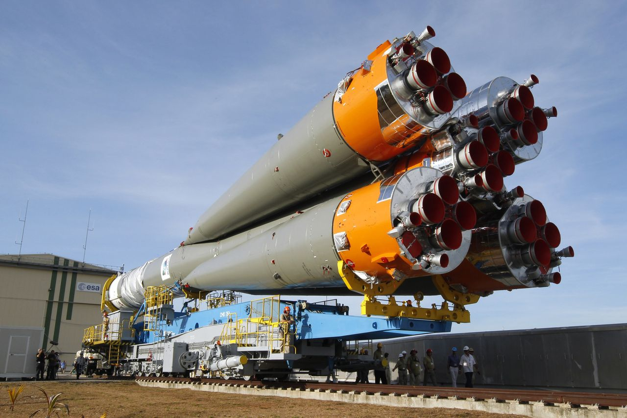 General view of the Soyuz VS01 rocket as it is transported to its launch pad at the Guiana Space Center in Sinnamary, French Guiana, October 14, 2011. The three-stage Soyuz ST-B comprises four first-stage boosters clustered around the core second stage, topped off by the third stage. The rocket will carry the first two satellites of Europe's Galileo navigation system into orbit on its scheduled October 20 launch. REUTERS/Benoit Tessier (FRENCH GUIANA - Tags: SCIENCE TECHNOLOGY)