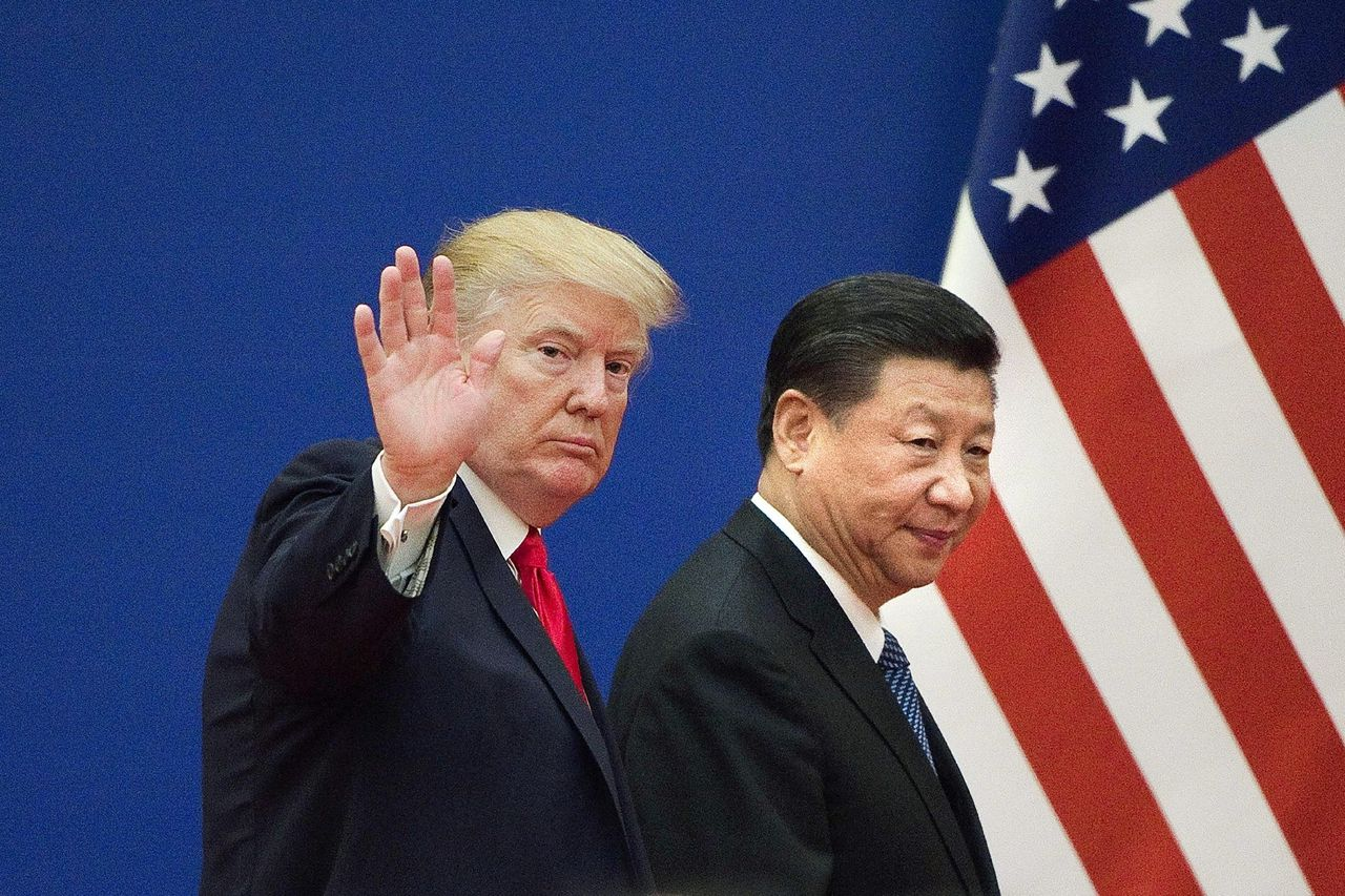 De Amerikaanse president Donald Trump (L) and China's President Xi Jinping in Beijing, november 2017.