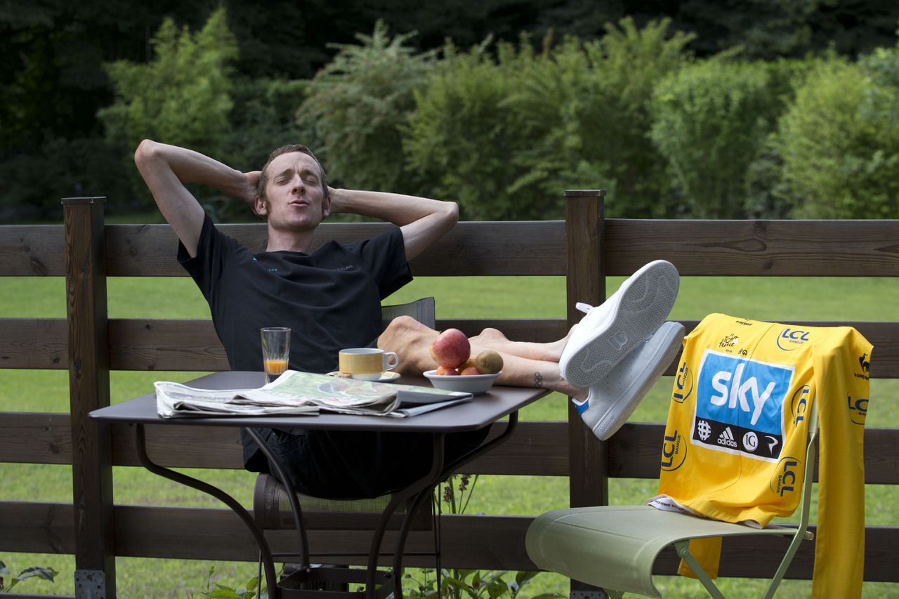 Overall leader Bradley Wiggins of Britain poses in a setting arranged by photographers on he rest day of the Tour de France cycling race at the team hotel in Quincie-en-Beaujolais, near Macon, France, Tuesday July 10, 2012. (AP Photo/Christophe Ena)