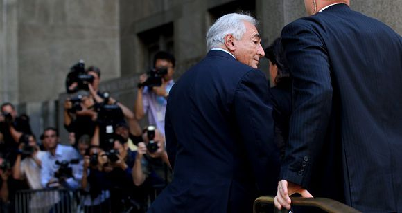 Caption: Dominique Strauss-Kahn enters the Criminal Courts Building in New York on Tuesday, Aug. 23, 2011. The case against Strauss-Kahn, who accused by Hotel housekeeper Nafissatou Diallo of sexual assault, was expected to be dismissed. (AP Photo/Craig Ruttle)