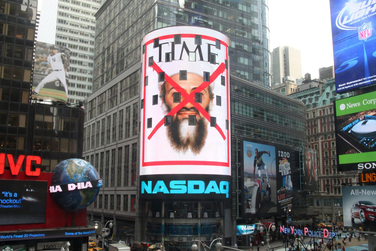 """This Monday, May 2, 2011 photo, provided by NASDAQ OMX Group, shows the cover of a special issue of Time magazine on the death of Osama bin Laden displayed on the Nasdaq screen in New York's Times Square. The issue, featuring a red """"X"""" over bin Laden's face, will hit newsstands on Thursday, May 5, 2011. The magazine says it is the fourth cover in TIME's history to feature the red """"X."""" Other covers showed Adolf Hitler on May 7, 1945, Saddam Hussein on April 21, 2003, and Abu Musab al-Zarqawi on June 19, 2006. (AP Photo/NASDAQ OMX Group, Inc.)"""