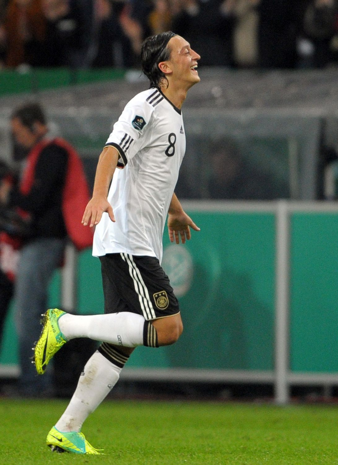 Germany's midfielder Mesut Oezil celebrates after scoring the first goal during the UEFA Euro 2012 qualifying match Germany vs Belgium on October 11, 2011 in Duesseldorf. Germany won 3-0. AFP PHOTO / JOHANNES EISELE