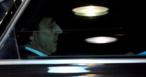 Caption: France President Nicolas Sarkozy is seen through a car window as he arrives for an informal dinner gathering European Union (EU) heads of State or government on the eve of an European Union summit at the EU headquarters on December 8, 2011 in Brussels. AFP PHOTO / GEORGES GOBET
