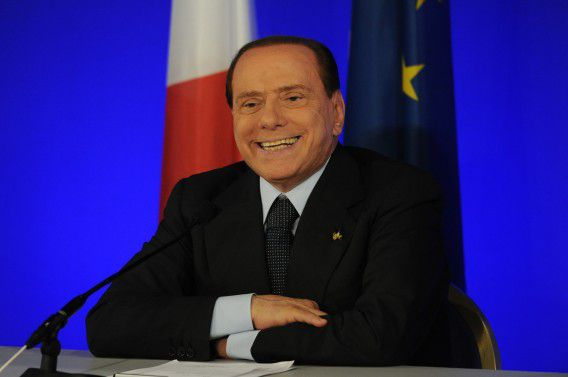 Italian Prime Minister Silvio Berlusconi smiles during a press conference on November 4, 2011 on the last day of the G20 Summit of Heads of State and Government in Cannes. World economic powers will attempt to kickstart the global economy on November 4 by boosting funds to fight the debt crisis and encouraging consumers to spend their way out of a threatened recession. AFP PHOTO / PASCAL GUYOT