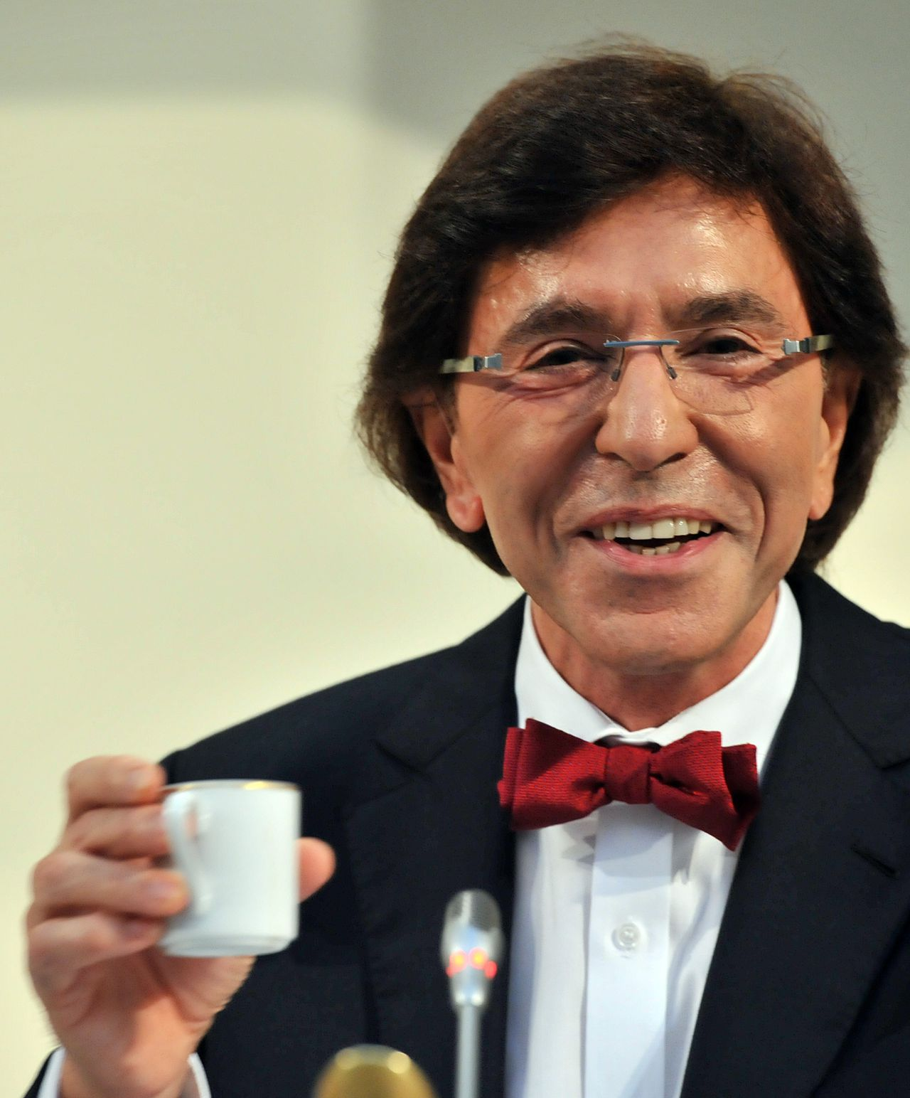 Belgian French-speaking Socialist leader Elio Di Rupo holds a cup gives a press conference on November 27,2011 at the Belgian Parliament in Brussels focused on the way ahead for a Belgium once more projecting a unified image. Elio Di Rupo, Belgium's premier-in-waiting, outlines the way ahead for his country, a day after ending a 19-month government paralysis with an EU-friendly budget under market pressure. AFP PHOTO / GEORGES GOBET
