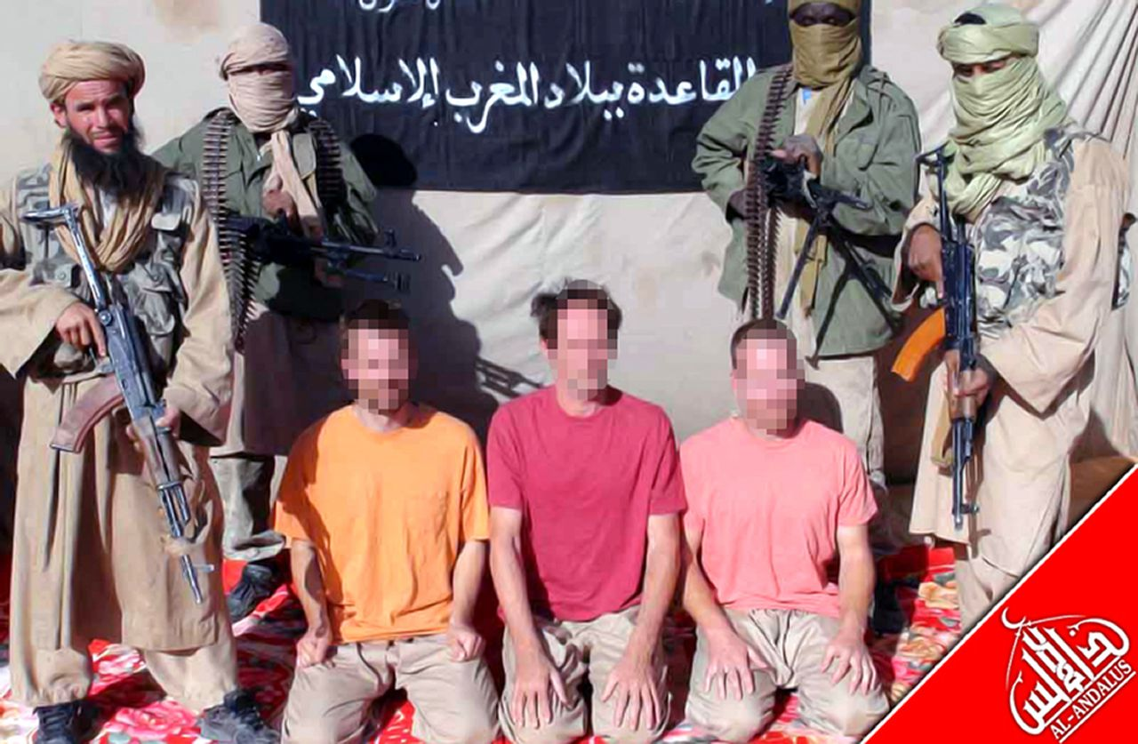 An undated handout image released by Al-Andalus, the media branch of Al-Qaeda in the Magreb (AQMI) to the Agence Nouakchott Informations (ANI) on December 9, 2011 shows three European hostages being held by AQMI at an undisclosed loaction. The three Europeans, a Swede, a Dutchman and a man with dual British-South African nationality were snatched from a restaurant on Timbuktu's central square on November 25. Operating from bases in northern Mali, AQIM have carried out attacks against troops and civilians and kidnappings, particularly of Westerners. AFP PHOTO/ANI / AQMI