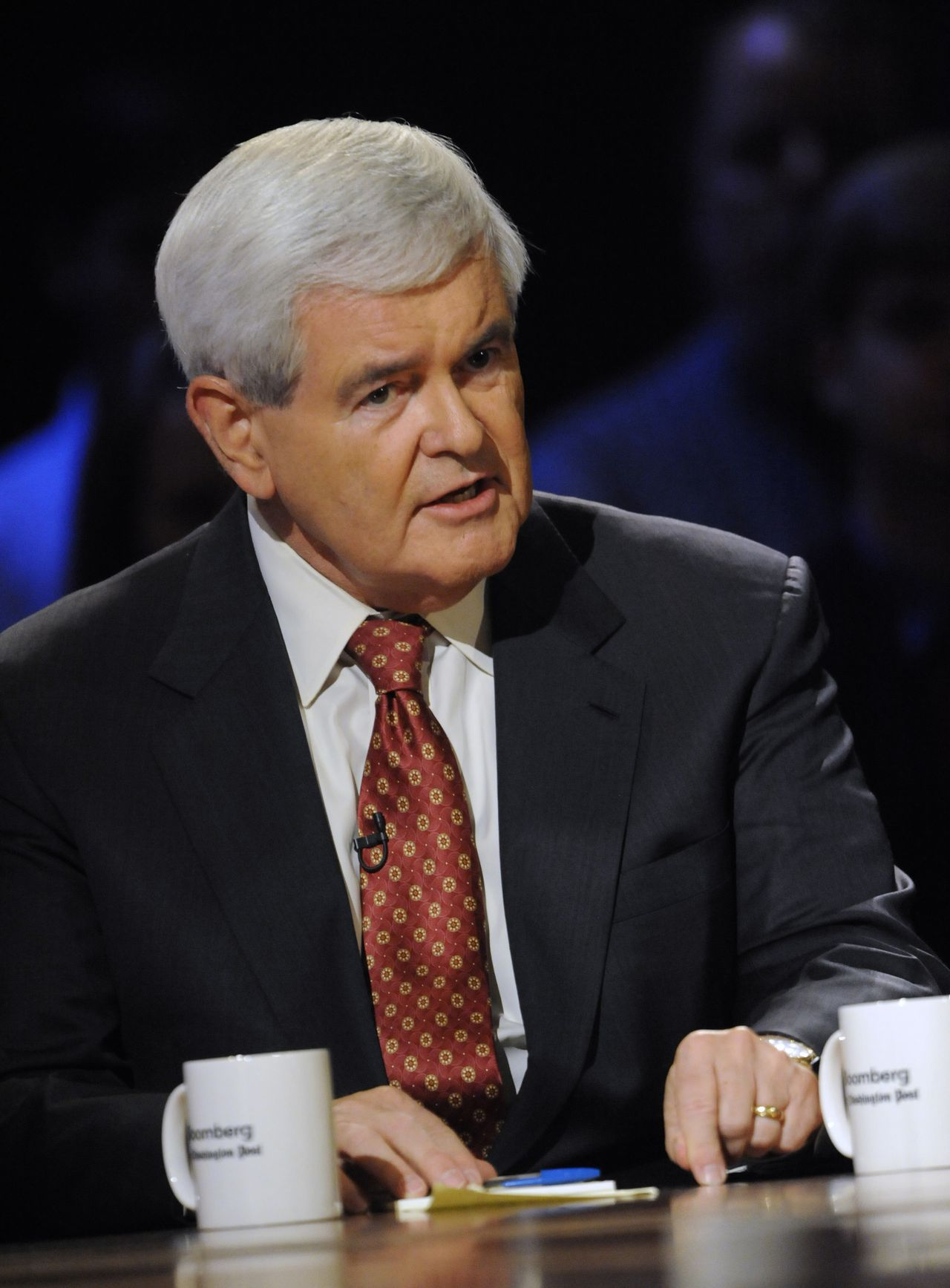 """FILE - In this Oct. 11, 2011, file photo Republican presidential candidate, former House Speaker Newt Gingrich, participates in a presidential debate at Dartmouth College in Hanover, N.H. The Georgia Republican said Sunday, Oct. 16, 2011, in Washington that he thinks President Barack Obama should have done more to reach out to ordinary Iranians when they protested against the regime. """"Our goal should be the replacement of the Iranian dictatorship."""" he said. (AP Photo/Melina Mara, Pool)"""