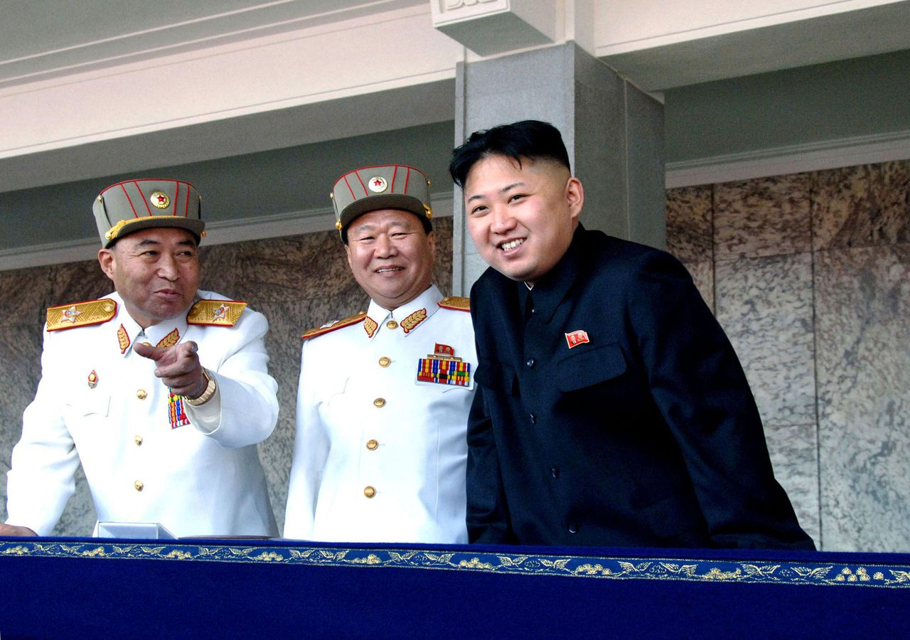 "---EDITORS NOTE--- RESTRICTED TO EDITORIAL USE - MANDATORY CREDIT ""AFP PHOTO / KCNA VIA KNS"" - NO MARKETING NO ADVERTISING CAMPAIGNS - DISTRIBUTED AS A SERVICE TO CLIENTS This picture, taken by North Korea's official Korean Central News Agency on April 15, 2012 shows North Korean leader Kim Jong Un (R) shares smiles with military officers as he reviews a military parade commemorating the 100th birth anniversary of former North Korean President Kim Il Sung at the Kim Il Sung Square in Pyongyang. AFP PHOTO / KCNA via KNS"
