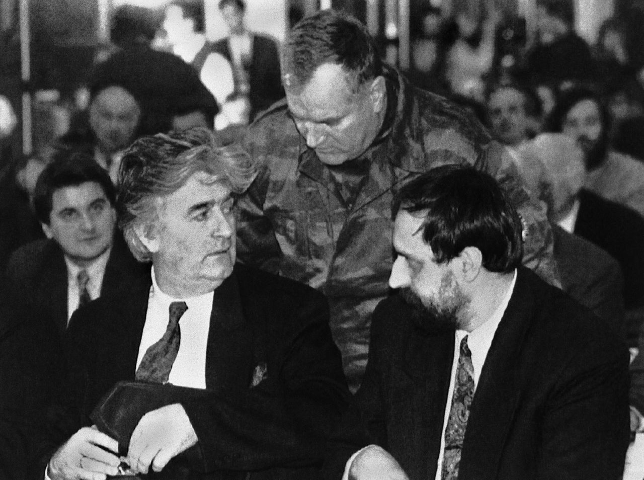 FILE In this Jan. 19, 1993 file photo, Leader of the Bosnian Serbs Radovan Karadzic, left, Commander in chief of Bosnia Serbian army Col. General Ratko Mladic, center, and Goran Hadzic, President of the Serbian Krajina Republic in Croatia talk at the start of the parliament session in Pale, Bosnia. It has been reported on Wednesday, July 20, 2011 by Serbian TV station B92 that authorities have arrested Goran Hadzic, the last remaining fugitive sought by the U.N. war crimes court. Hadzic has been on the run for eight years. He is wanted for atrocities stemming from the 1991-1995 war in Croatia. (AP Photo/Srdjan Ilic, File)