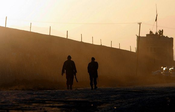 Afghan soldiers patrol outside the Pul-i-Charkhi prison on the eastern outskirts of Kabul,