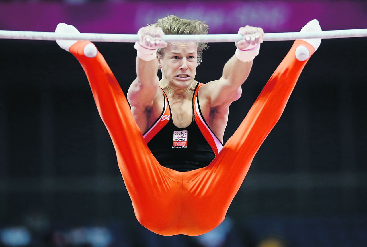 Gymnast from the Netherlands Epke Zonderland performs on the horizontal bar during the Artistic Gymnastics men's qualification at the 2012 Summer Olympics, Saturday, July 28, 2012, in London. (AP Photo/Matt Dunham)