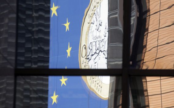 The euro sign is reflected in a window of EU headquarters in Brussels on Monday, Feb. 20, 2012. Leaders from Germany, Italy and Greece have said they are optimistic that the deal on a second massive bailout for Athens can be clinched at a meeting of EU finance ministers on Monday after months of delay, but critics have expressed doubts over Greek political leaders' commitment to austerity and there are still difficult details to be ironed out. (AP Photo/Virginia Mayo)