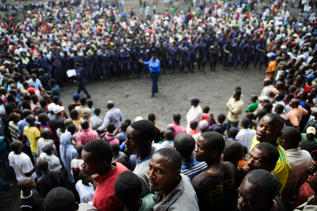 Residents of Goma gather at the Volcanoes Stadium in Goma on November 21, 2012. M23 rebels called on the population of Goma to come to the stadium today in an attempt to calm and reassure civilians following the fall of the city yesterday by the rebel group. AFP PHOTO / PHIL MOORE