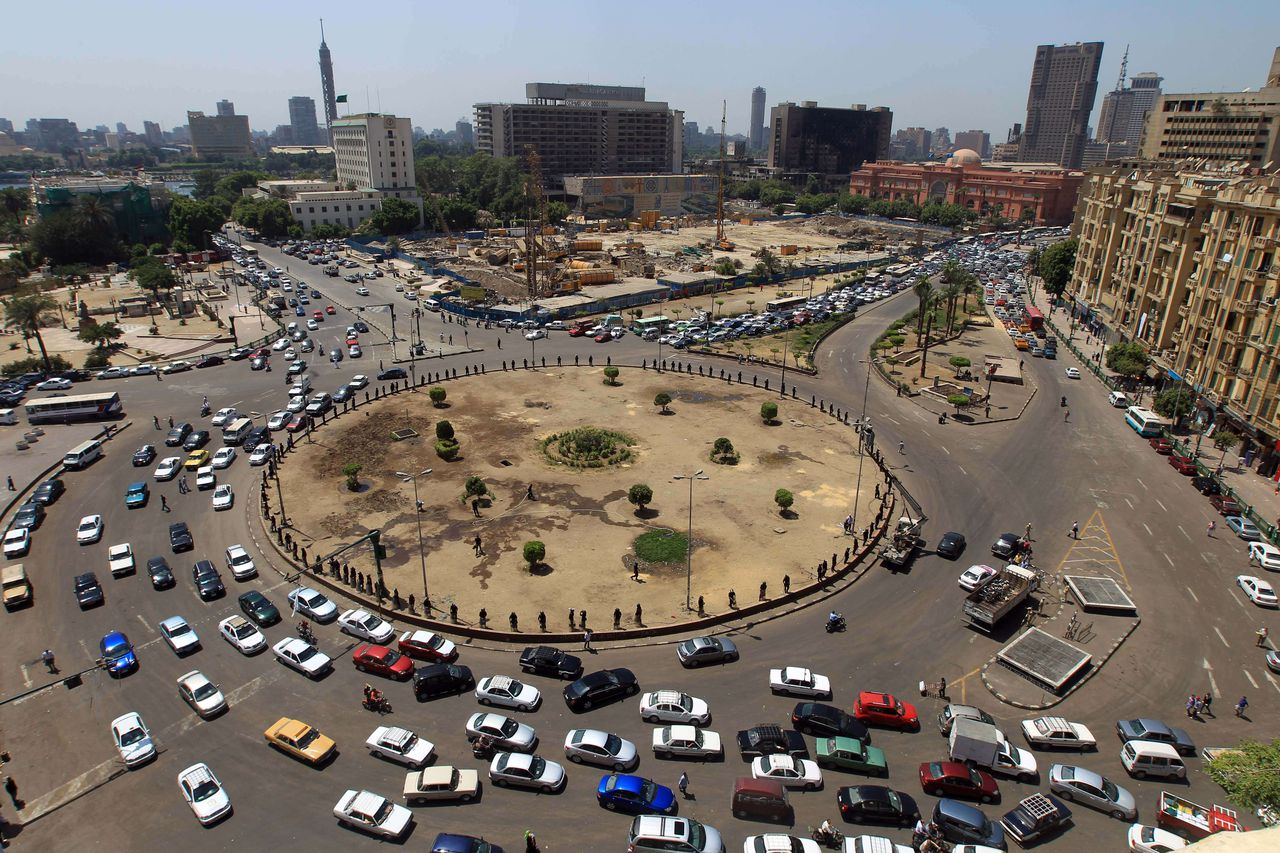 Traffic circulates around Tahrir Square after the police removed demonstrators who refused to leave the area after most groups had suspended a sit-in for the month of Ramadan, in Cairo on July 2, 2011. AFP PHOTO / KHALED DESOUKI