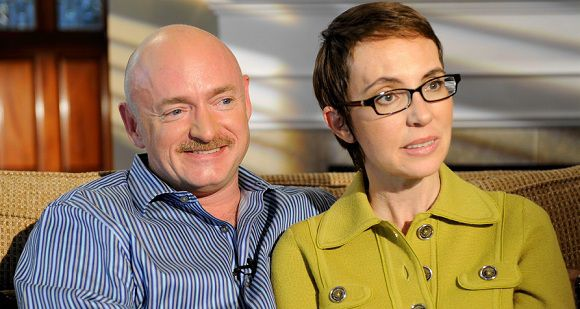 Caption: In this undated photo provided by ABC, U.S. Rep. Gabrielle Giffords and husband Mark Kelly are interviewed by Diane Sawyer on ABC's 20/20. The show, featuring the first public interview Giffords has given since she was shot in the head in Tucson last winter, will air Monday, Nov. 14, 2011. (AP Photo/ABC, Ida Mae Astute)