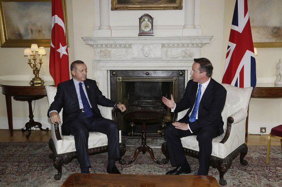Prime Minister Tayyip Erdogan (L) of Turkey speaks with Britain's Prime Minister David Cameron at Downing Street in London July 27, 2012. Erdogan will also attend the inauguration ceremony of 2012 London Olympic Games as Cameron's guest. REUTERS/Matthew Lloyd/Pool (BRITAIN - Tags: POLITICS SPORT OLYMPICS)