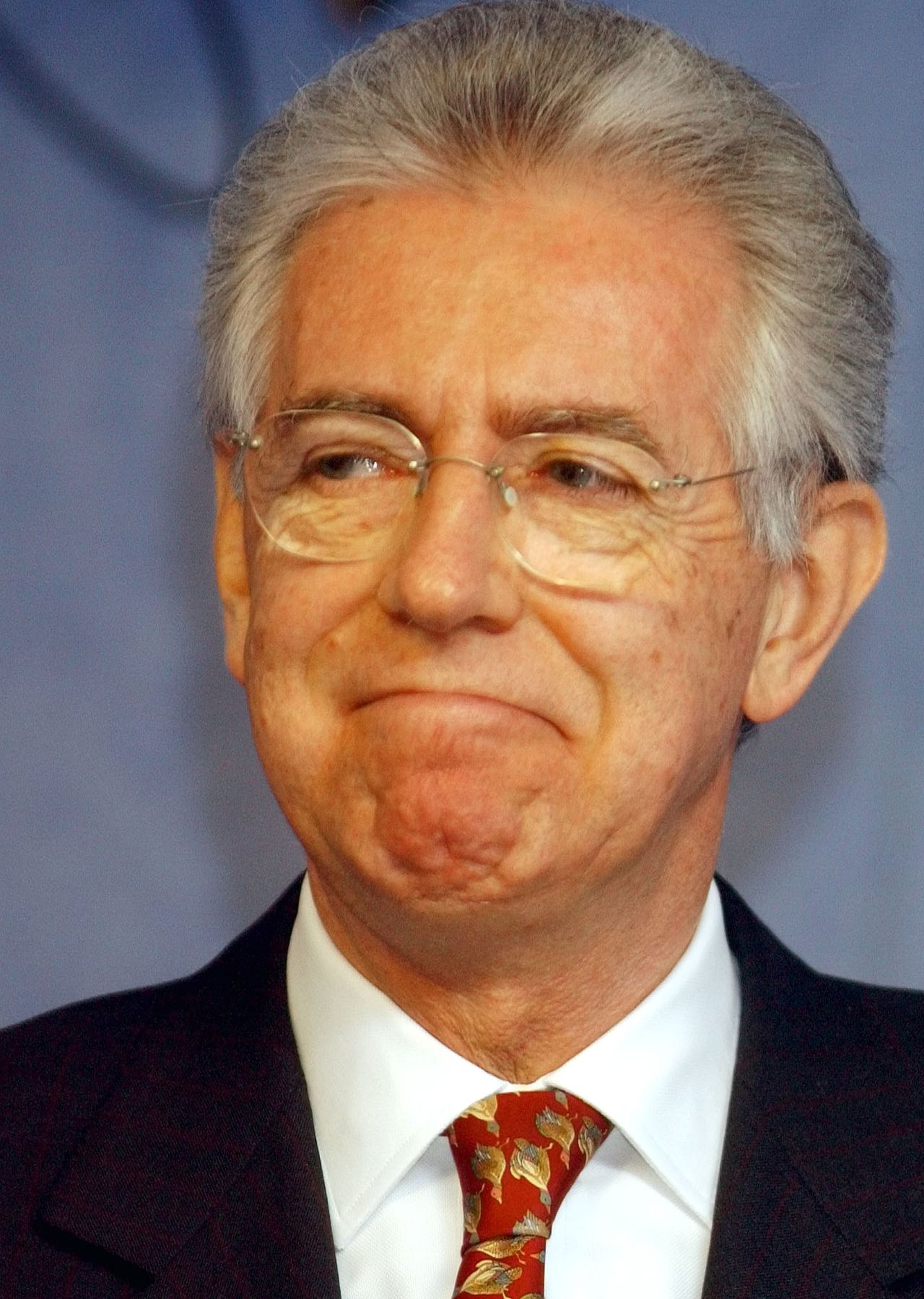 FILE - In this March 18, 2004 file photo, European Competition Commissioner Mario Monti speaks during a media conference at EU headquarters in Brussels. Italy's president moved swiftly Wednesday, Nov. 9, 2011, to reassure anxious markets, promising that Silvio Berlusconi would soon be vacating the premier's office and unexpectedly lavishing praise on economist Mario Monti, who might lead the debt-plagued country's next government. (AP Photo/Geert Vanden Wijngaert, File)