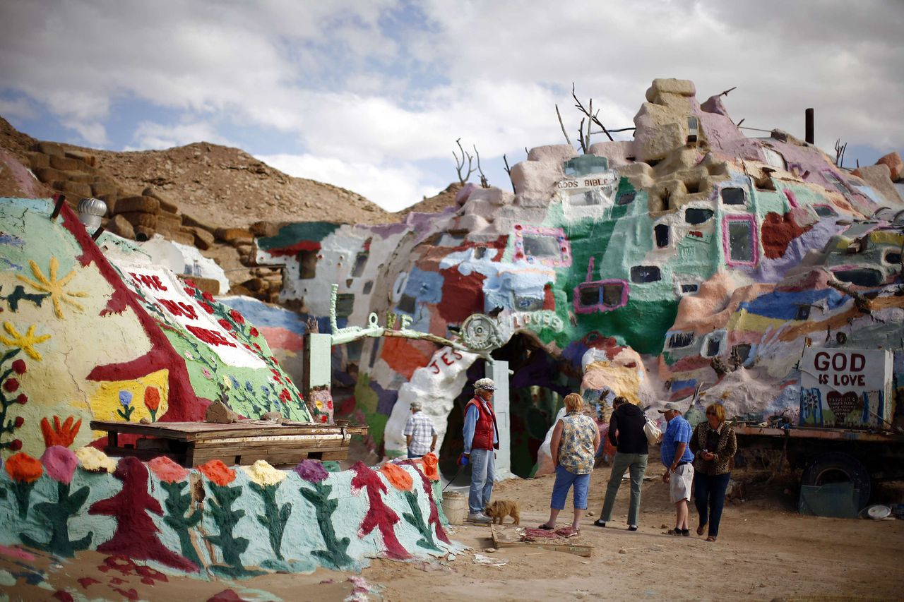 """ATTENTION EDITORS: PICTURE 28 OF 30 FOR PACKAGE 'LIFE IN SLAB CITY' An art installation called """"Salvation Mountain"""" is seen in Slab City just outside Niland, California February 15, 2012. A former military base that was closed after World War II, Slab City is a place on the fringe both geographically and philosophically and attracts a variety of people, including jobless and financially struggling recession refugees who can no longer pay for food and housing. Picture taken February 15, 2012. REUTERS/Eric Thayer (UNITED STATES - Tags: SOCIETY TPX IMAGES OF THE DAY) BUSINESS)"""