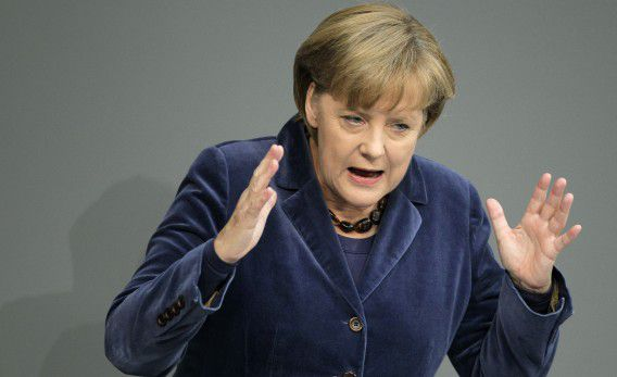 German Chancellor Angela Merkel gestures during her speech at the German federal parliament, Bundestag, in Berlin, Germany, Wednesday, Oct. 26, 2011. (AP Photo/Michael Sohn)