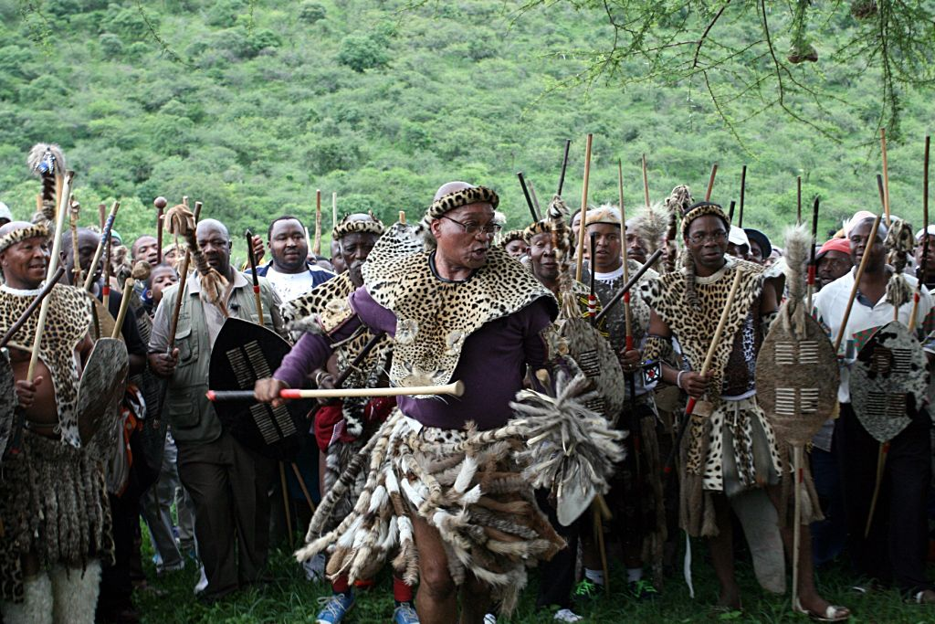 """South Africa's President Jacob Zuma's dances during a traditional ritual in Nkandla on November 25, 2012 to help him keep his job. One clan elder calling on the ancestors to protect Zuma against his rivals ahead of an African National Congress (ANC) leadership vote next month. """"We appeal to you all ... ancestors, to be with him, to guide him and protect him against those ganging up against him,"""" Maqhinga Zuma said at the ceremony in Nkandla where an upgrade to the leader's private home has sparked controversy. AFP PHOTO / Stringer"""