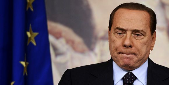 Caption: (FILES) This file picture taken on October 22, 2010 during a press conference in Rome's Palazzo Chigi shows Italian Prime Minister Silvio Berlusconi. Italian Prime Minister Silvio Berlusconi said in an interview published on November 9, 2011 that he will not run for office at the next election and will step down by the end of the month.AFP PHOTO / FILES / FILIPPO MONTEFORTE