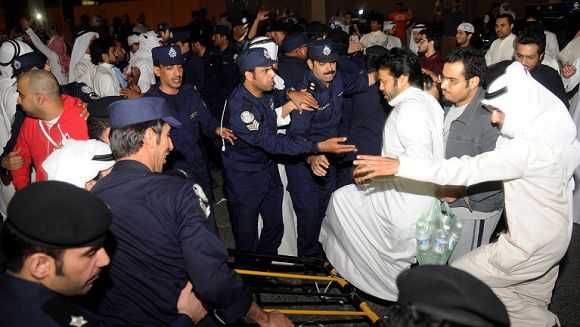 Caption: Dozens of Kuwaitis briefly stormed Kuwait's parliament building as hundreds of others protested outside in Kuwait City late Wednesday, Nov. 16, 2011. Opposition lawmakers warned Wednesday of a growing political crisis after dozens of anti-government protesters muscled their way into the parliament during debate over efforts to question Prime Minister Sheik Nasser Al Mohammad Al Sabah about corruption allegations. (AP Photo/Nasser Waggi)