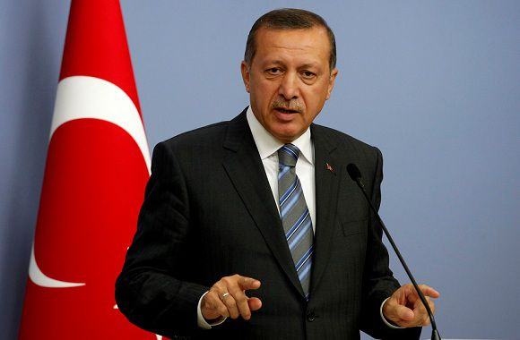 Caption: Turkey's Prime Minister Tayyip Erdogan addresses the media in Ankara September 8, 2011. Turkey's plan to flex its naval muscles in the eastern Mediterranean risks being perceived as an over-reaction in Ankara's dispute with former ally Israel and as an assertion of regional power that could alienate even its new Arab admirers. Erdogan's ploy may fuel Western unease about Turkey's reliability as a NATO partner and its penchant for actions designed to court popularity in the Muslim world. REUTERS/Umit Bektas (TURKEY - Tags: POLITICS)