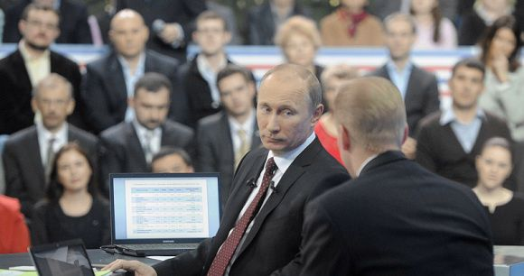 Caption: Russian Prime Minister Vladimir Putin (2nd R) listens during a televised question-and-answer session in Moscow December 15, 2011. Putin on Thursday deflected opposition allegations that fraud helped his ruling party win a parliamentary election, saying the result reflected the views of the population. REUTERS/Alexsey Druginyn/RIA Novosti/Pool (RUSSIA - Tags: POLITICS) THIS IMAGE HAS BEEN SUPPLIED BY A THIRD PARTY. IT IS DISTRIBUTED, EXACTLY AS RECEIVED BY REUTERS, AS A SERVICE TO CLIENTS
