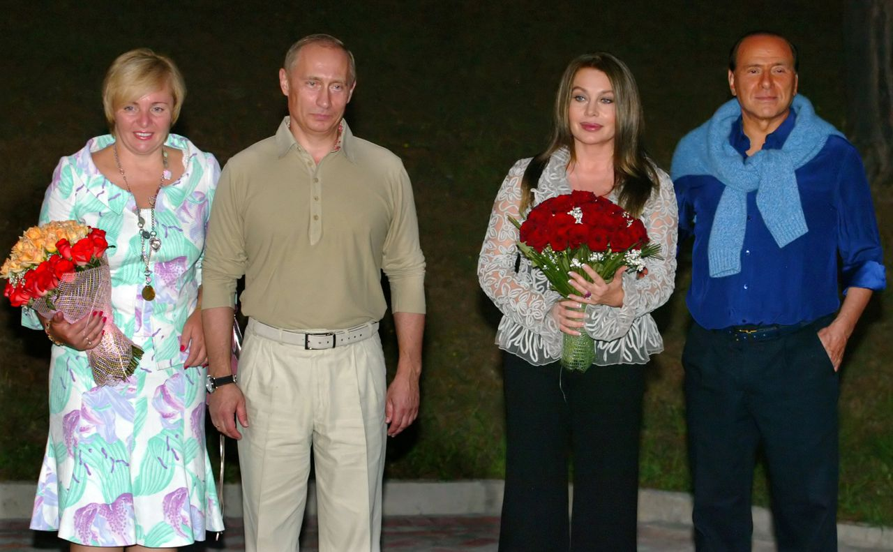 FILE - In this file photo taken on Sunday, Aug. 28, 2005, from left: then wife of Russian President Lyudmila Putina, Russian President Vladimir Putin, wife of Italian Prime Minister Silvio Berlusconi's ex-wife Veronica Lario, and Italian Prime Minister Silvio Berlusconi pose for photographers during the meeting in Putin's residence in the Russian Black Sea resort of Sochi. Russian President Vladimir Putin and his wife Lyudmila said Thursday, June 6, 2013, they are divorcing after nearly 30 years of marriage, making the announcement on state television after attending a ballet performance at the Kremlin. (AP Photo/Mikhail Metzel, File)
