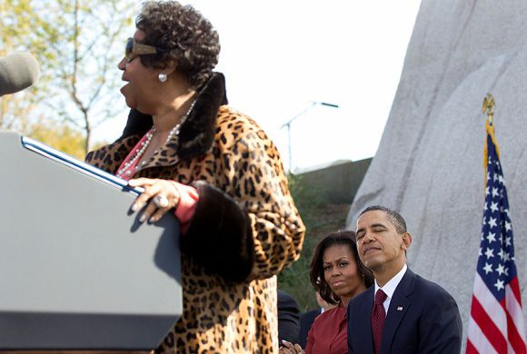Caption: President Barack Obama closes his eyes as he and first lady Michelle Obama to listen to Aretha Franklin sings during the dedication ceremony for the Martin Luther King Jr. Memorial Sunday, Oct. 16, 2011, on the National Mall in Washington. (AP Photo/Carolyn Kaster)