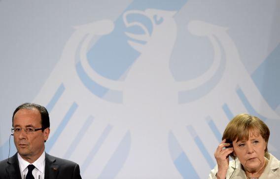 Hollande en Merkel vorig jaar in Berlijn tijdens een persconferentie.