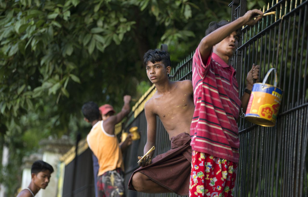 In this picture taken on Saturday Nov 17, 2012,workers paint the fence of Yangon University, where President Barack Obama is scheduled to deliver a speech on Monday, Nov. 19, 2012, Yangon, Myanmar. Since colonial times, the fight for change in Myanmar has begun on this leafy campus. It was a center of the struggle for independence against Britain and served as a launching point for pro-democracy protests in 1962, 1974, 1988 and 1996. For many, the school has today become a symbol of the country's ruined education system and a monument to a half century of misrule. (AP Photo/Gemunu Amarasinghe)