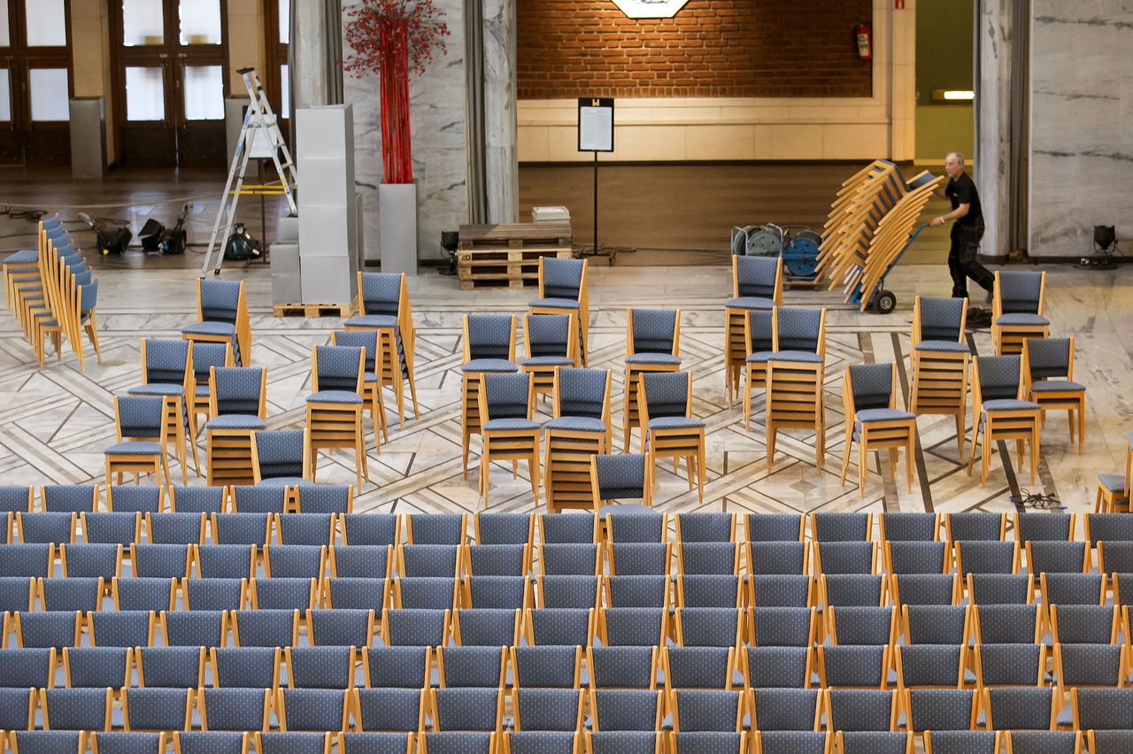 A worker wheels out chairs in preparations for the Nobel Peace Price ceremony, in Oslo City Hall, Norway, Friday, Dec. 7, 2012. (AP Photo/Heiko Junge, NTB Scanpix)