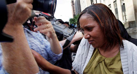 Caption: Nafissatou Diallo (C), the Manhattan maid who has accused Dominique Strauss-Kahn of sexually assaulting her, is escorted from Manhattan Criminal Court after meeting with her lawyers and the New York District Attorney in New York July 27, 2011. REUTERS/Shannon Stapleton (UNITED STATES - Tags: CRIME LAW BUSINESS)