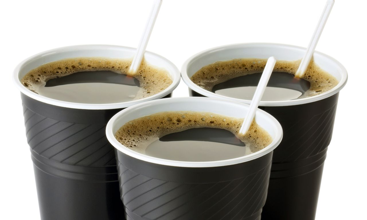 Three vending coffee cups. Isolated on a white.