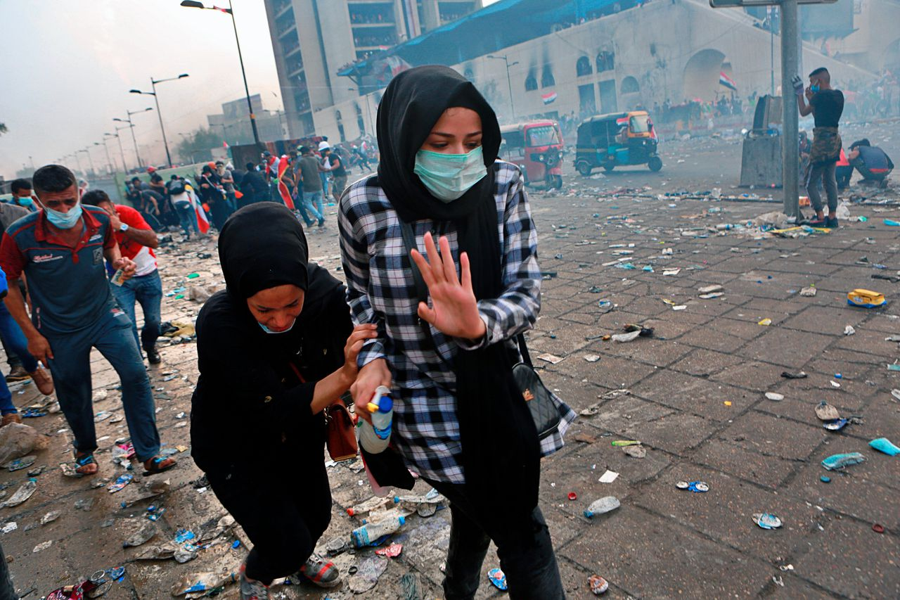 Iraqi demonstrating girls attacked by police tear gas, photo by Khalid Mohammed/AP