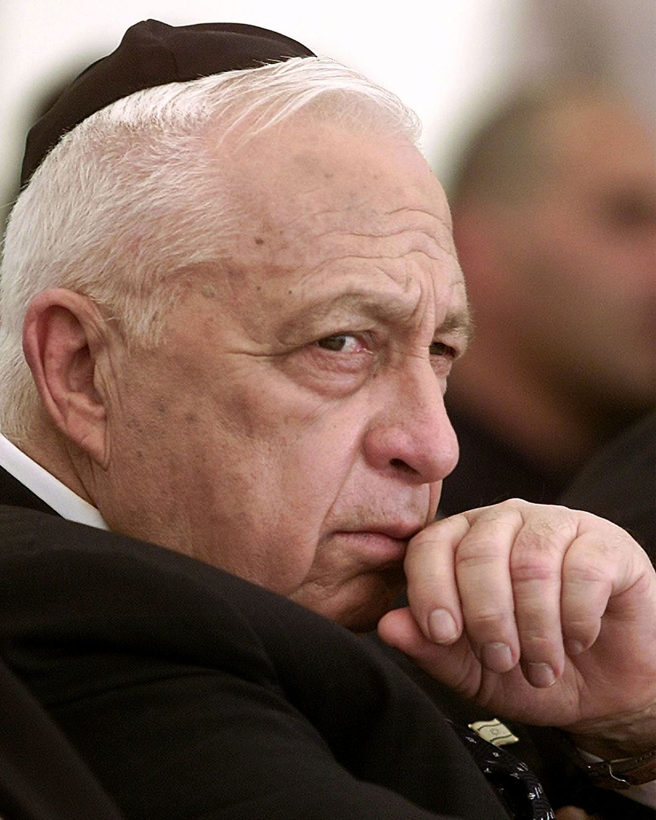 Israeli Prime Minister Ariel Sharon attends an opening of Memorial Day for fallen soldiers in Jerusalem in this April 15, 2002 file photo. Sharon, a dominant figure for decades in shaping the Middle East, was rushed to hospital on January 4, 2006 for surgery after suffering a massive brain haemorrhage. REUTERS/Nir Elias/Files