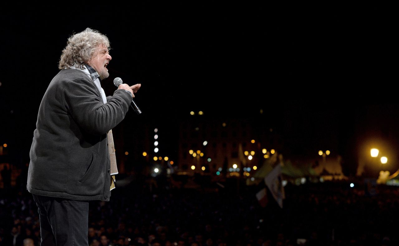 Comedian-turned-political agitator, Beppe Grillo, speaks during his final rally in Rome's Piazza San Giovanni on February 22,2013. Italians are fed up, and no one is tapping that emotional vein better than comic-turned-political agitator Beppe Grillo and his anti-establishment 5 Star Movement. Grillo's campaign is significant not only because he shows strong chances of being the third or even the second party in Parliament after the Sunday and Monday vote. AFP PHOTO / FILIPPO MONTEFORTE