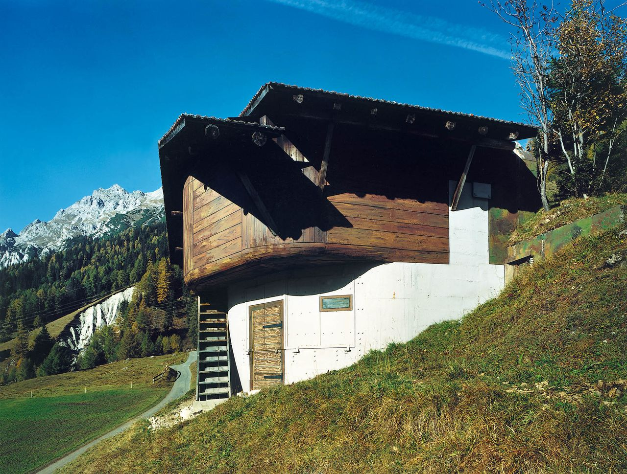 This undated handout picture taken by Christian Schwager and presented at the Bellpark Museum in Kriens, shows a Swiss military bunker camouflaged in faux-painting as a typical Alpine chalet somewhere in the Swiss countryside. 120 of these presented pictures expose the existence up until 2001 of over 1000 of these chalets and stables around the Swiss landscape. AFP PHOTO/CHRISTIAN SCHWAGER/BELLPARK MUSEUM/HO