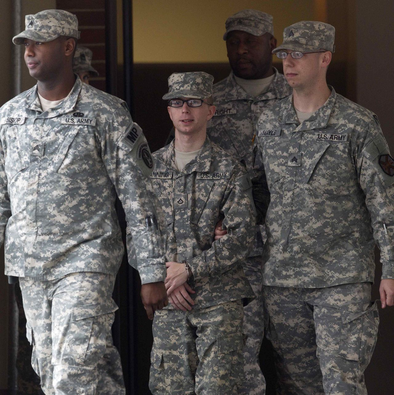 Army Pfc. Bradley Manning (C) is escorted by military police from the courthouse after the sixth day of his Article 32 hearing at Fort Meade, Maryland, December 21, 2011. The 24-year-old Manning is charged with downloading thousands of classified or confidential files from the military's Secret Internet Protocol Router Network, or SIPRNet. Those files are thought to have later appeared on WikiLeaks, a whistleblower website. REUTERS/Benjamin Myers (UNITED STATES - Tags: MILITARY CRIME LAW)