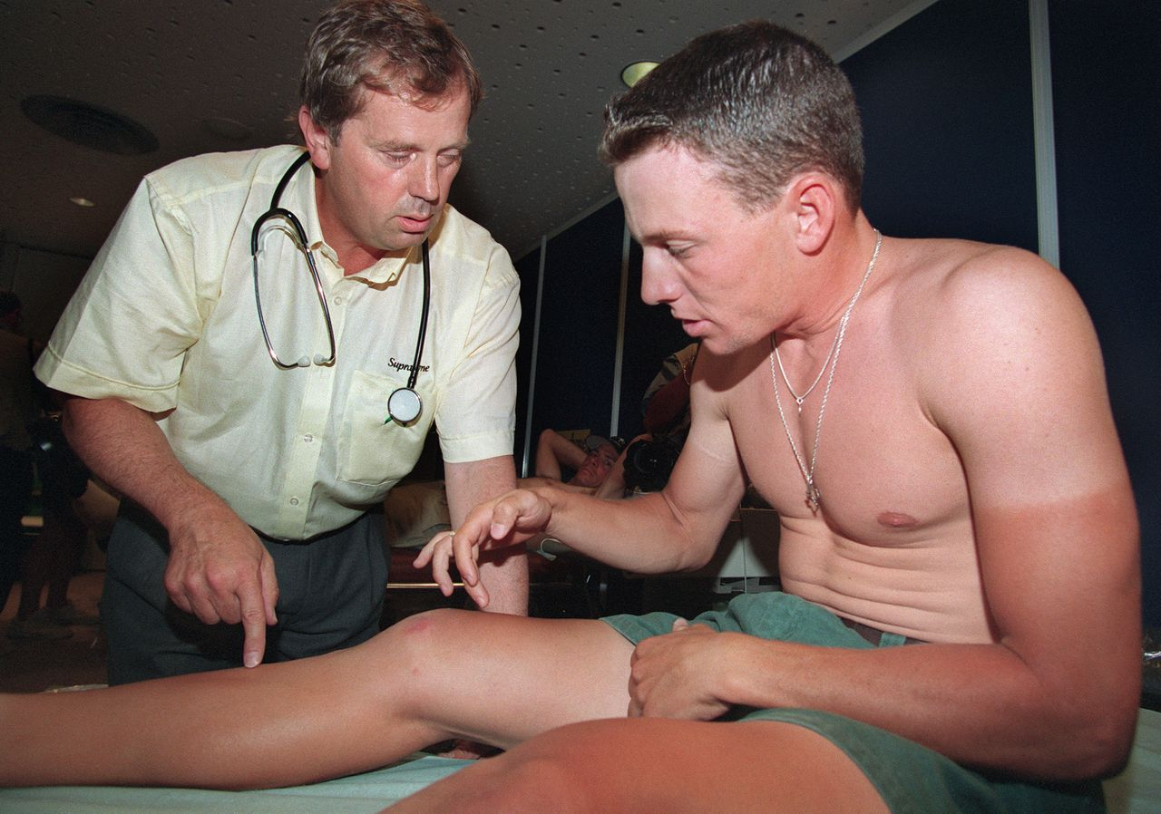 US Lance Armstrong shows the doctor his injured knee in the northern city of Lille 30 June 1994, two days before the start of the Tour de France cycling race. Seven-time Tour de France winner Lance Armstrong allegedly admitted taking banned doping products before suffering from cancer, according to evidence given under oath to a court in Dallas earlier this year and published in Saturday's edition of French daily Le Monde. AFP PHOTO/Pascal PAVANI