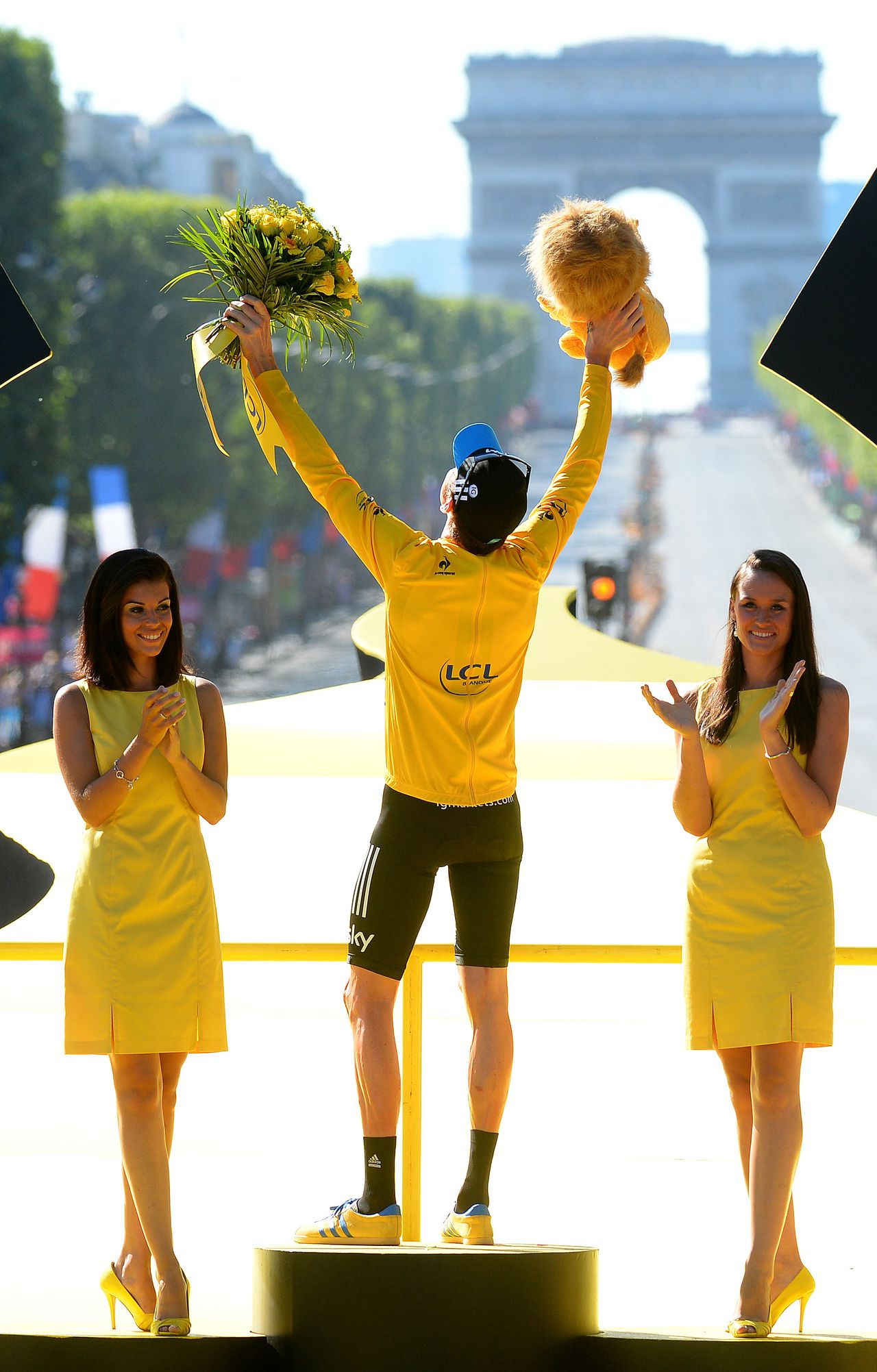 Bradley Wiggins, winner of the 2012 Tour de France cycling race celebrates on the podium of the the Tour de France cycling race in Paris, France, Sunday July 22, 2012. (AP Photo/Jerome Prevost, Pool)