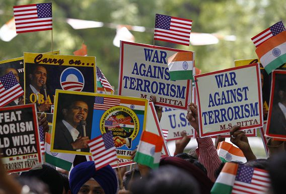 Members of the All India Anti-Terrorist Front (AIATF) hold placards and U.S. and Indian flags in New Delhi May 3, 2011, during a pro-U.S. rally as they celebrate the killing of Osama bin Laden. Bin Laden was killed in a U.S. special forces assault on a Pakistani compound, then quickly buried at sea, in a dramatic end to the long manhunt for the al Qaeda leader who had been the guiding star of global terrorism. REUTERS/Adnan Abidi (INDIA - Tags: POLITICS)