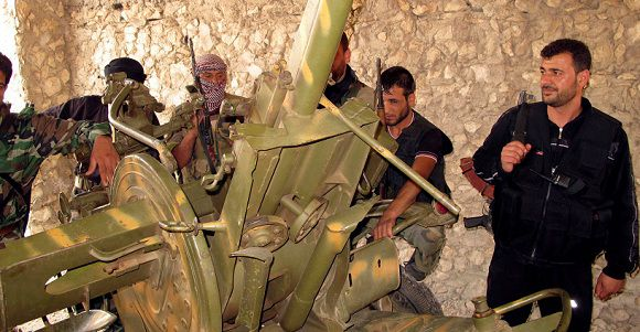 Caption: Members of Syrian free army inspect weapons after they captured a government army base in Daret Azzah near Aleppo June 24, 2012. Picture taken June 24. REUTERS/ABDO (SYRIA - Tags: POLITICS CONFLICT CIVIL UNREST)