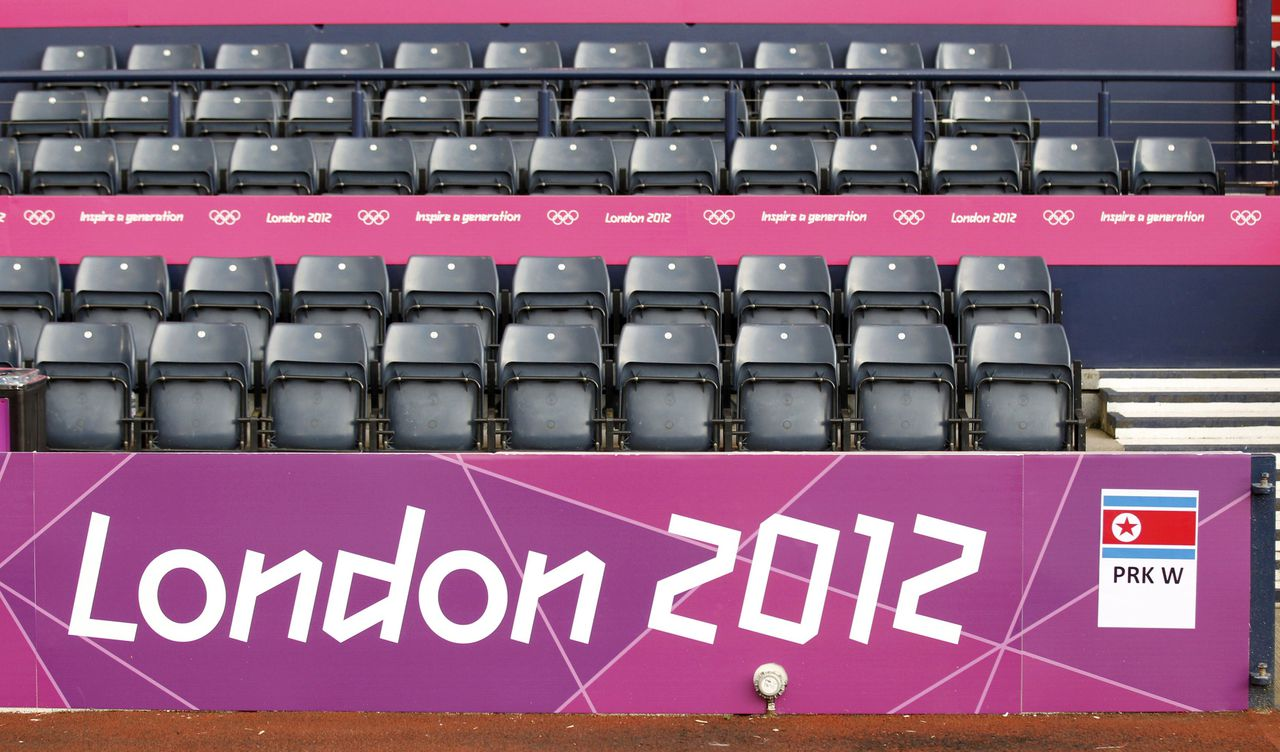 Empty seats are seen in the stands ahead of the women's Group G football match between North Korea and Colombia at the London 2012 Olympic Games in Hampden Park, Glasgow, Scotland July 25, 2012. REUTERS/David Moir (BRITAIN - Tags: SPORT OLYMPICS SPORT SOCCER)