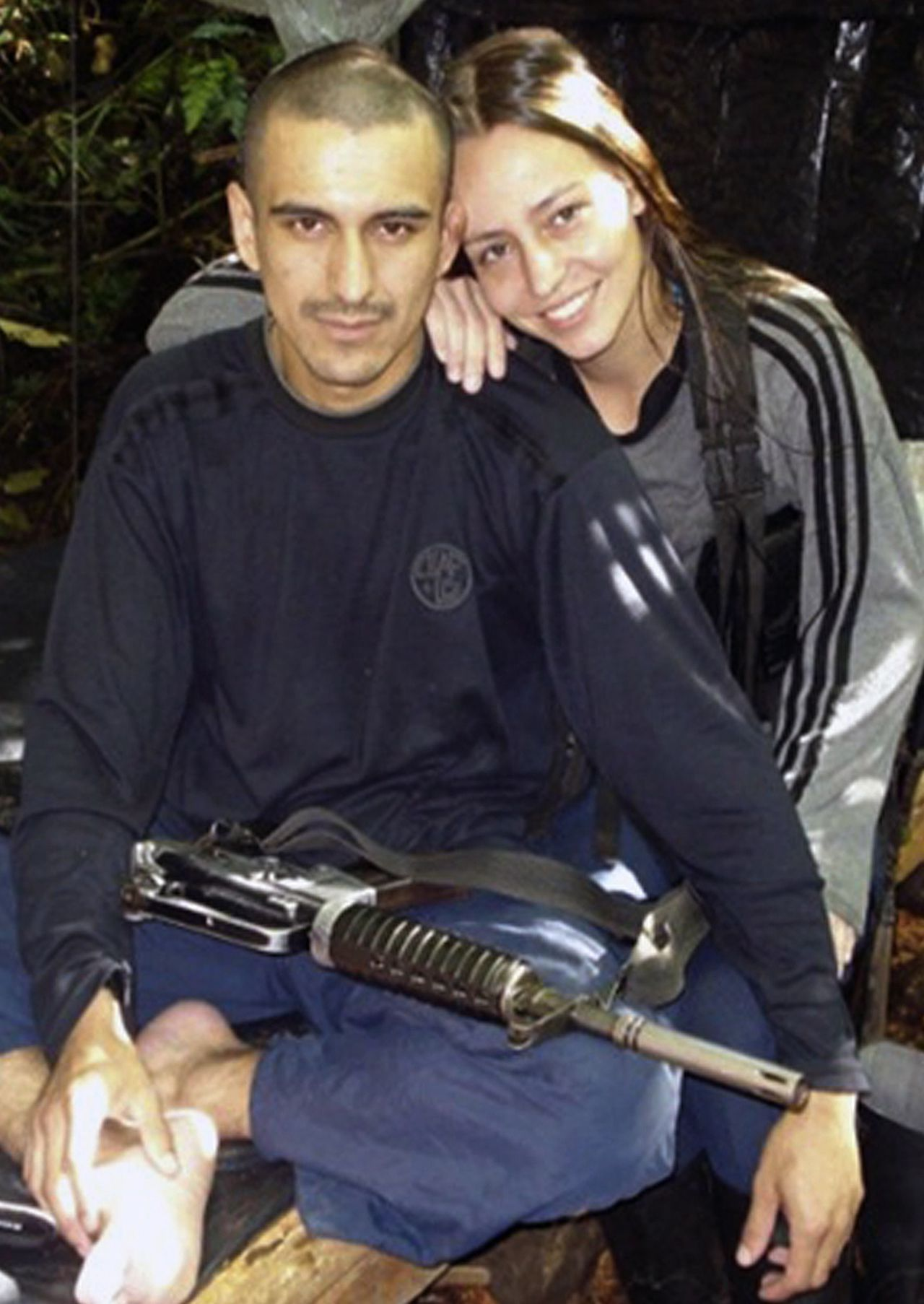 (FILE) Undated handout picture released by Colombia's presidential press service in 2010 showing Dutch citizen Tanja Nijmeijer (R), an alleged member of the Marxist guerilla group Revolutionary Armed Forces of Colombia (FARC) since 2002, posing at a guerilla camp in the jungle of Colombia. A peace dialogue between Colombia's FARC rebels and the government, which aims to end the country's decades-long conflict, will finally start in Oslo on October 18, the Colombian president's office said. Earlier this month Colombian press reports had suggested that the FARC's departure had been delayed partly by the group's bid to add a Dutch guerrilla, 34-year-old Tanja Nijmeijer, to their delegation for the talks. The Dutch national is alleged to have joined the FARC in the past decade during her studies in Colombia and has been accused of taking part in 2003 in the kidnap of three US citizens working for a security firm. AFP PHOTO/HO