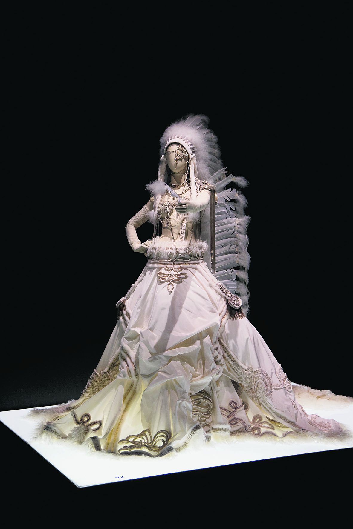 """A wedding dress by French fashion designer Jean Paul Gaultier is displayed at the opening of his exhibit """"The Fashion World of Jean Paul Gaultier"""", from the sidewalk to the catwalk, at Kunsthal museum in Rotterdam, Netherlands, Friday Feb. 8, 2013. The exhibit opens to the public on Feb. 10, 2013. (AP Photo/Peter Dejong)"""