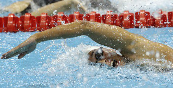 Netherlands' Ranomi Kromowidjojo in a women's 100-meter freestyle swimming heat at the Aquatics Centre in the Olympic Park during the 2012 Summer Olympics in London, Wednesday, Aug. 1, 2012. (AP Photo/Michael Sohn)